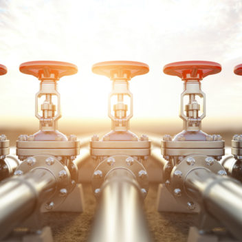 Oil or gas pipe line valves. Oil and gas extraction, production and transportation industrial background.